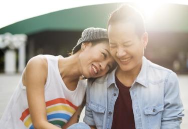 photo of two asian women laughing