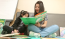 Adult woman reading book to child.