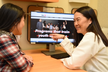 Photo of Dr. Angela Chan talking to patient