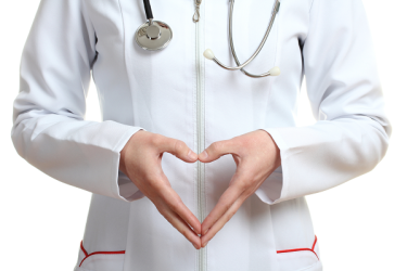 Doctor making heart shape sign with hands