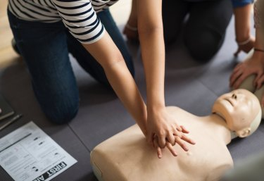 image of person giving mannequin CPR