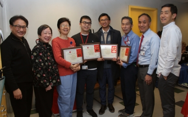 photo of employee of the year award winners with administrative staff